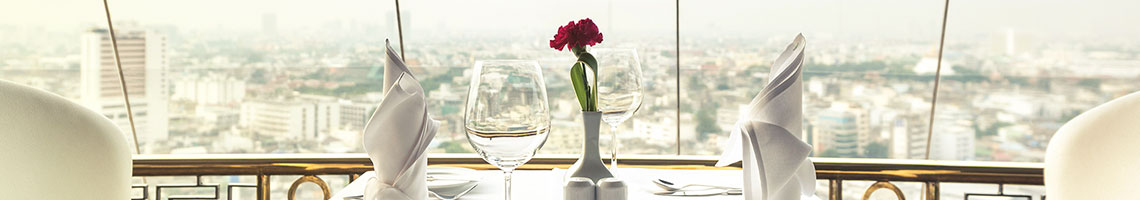 A nice restaurant diner table with a city view