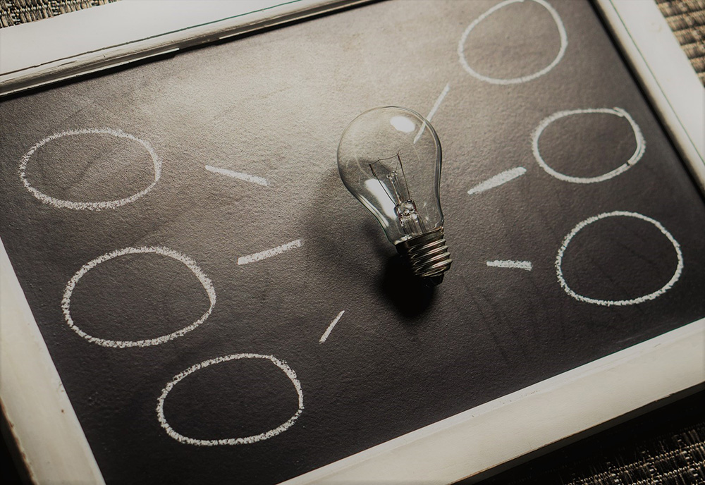 Lightbulb ideas on chalkboard
